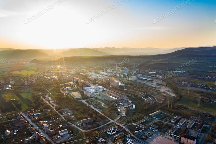 Aerial view of factory  in the sunset.
