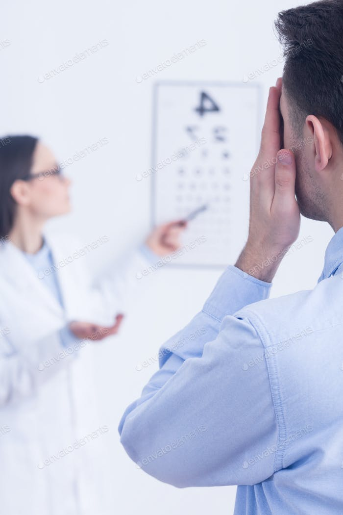 Man having eye sight test