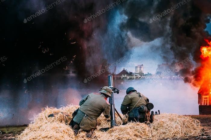 Re-enactors Dressed As World War II German Soldiers Fired From A