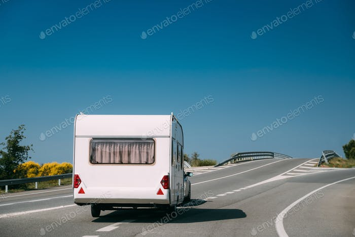 White Colour Motorhome Car Goes On Motorway Road