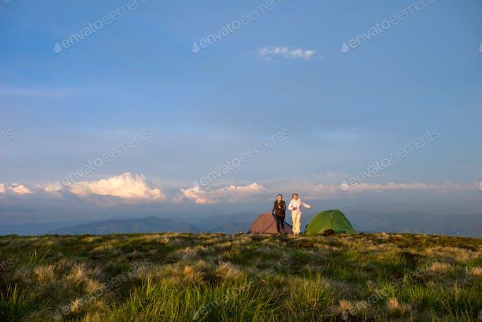 woman resting near tents