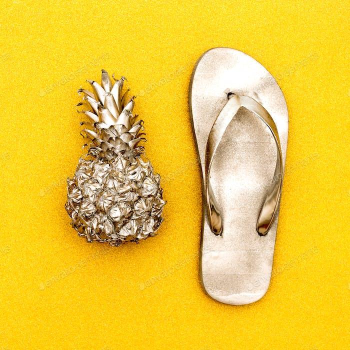 Minimal beach style. Pineapple and flip-flops