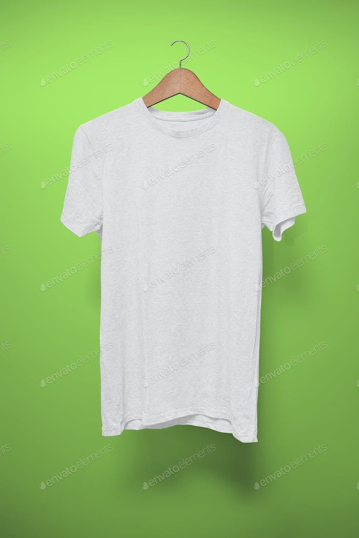White T-Shirt on a hanger against a green background