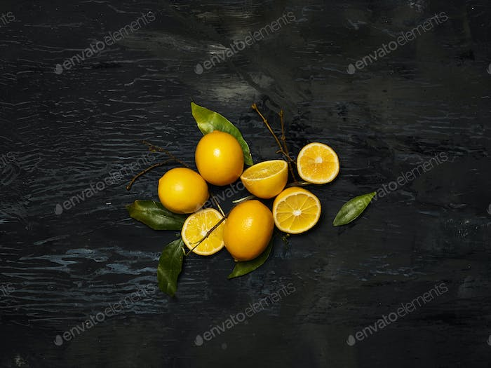 The fresh lemons on black background