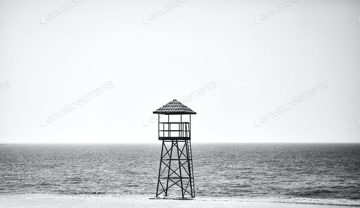 Lifeguard tower on an empty beach.