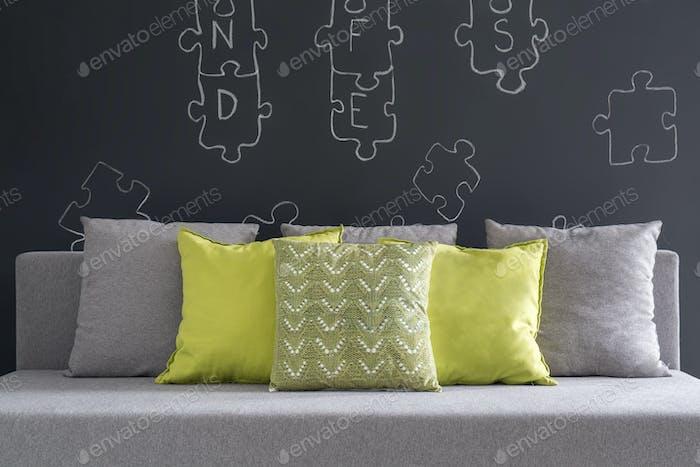 Sofa with green cushions