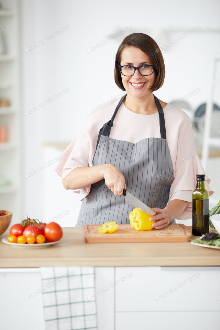 Woman standing in domestic kitchen