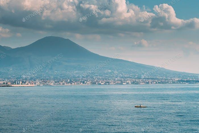 Naples, Italy. Man Training On Kayak In Tyrrhenian Sea. Landscap