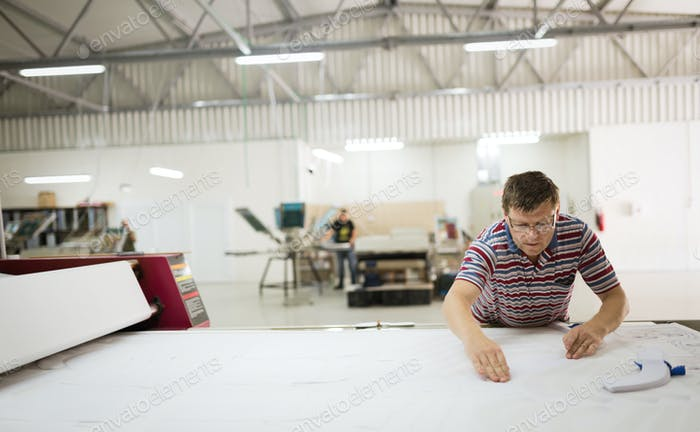 Industrial clothing designer working according to scheme