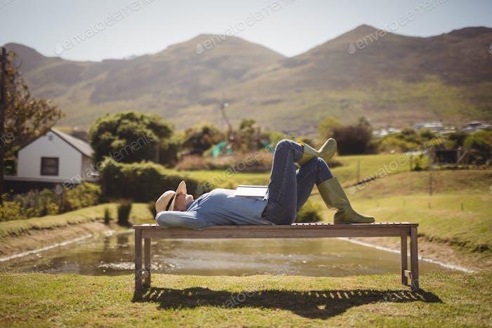 Senior woman sleeping on the park bench