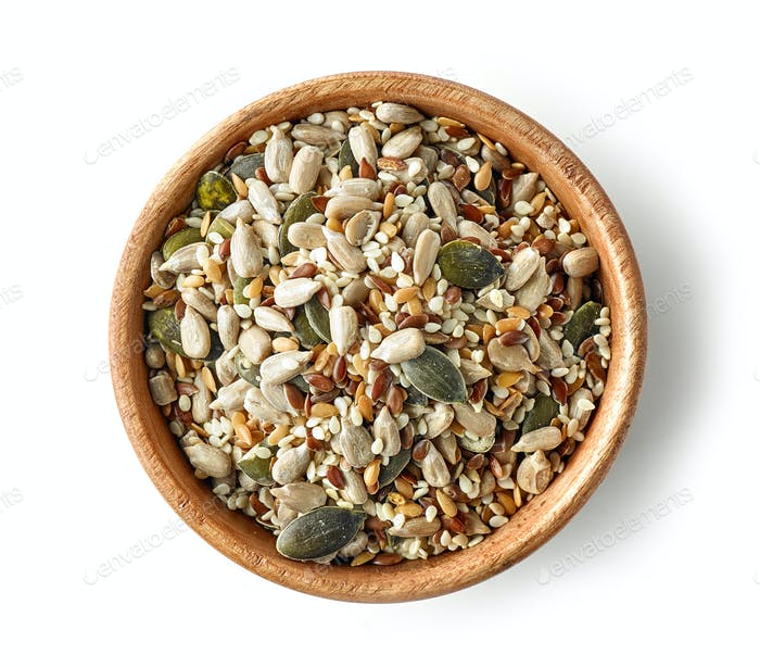 mix of seeds in wooden bowl