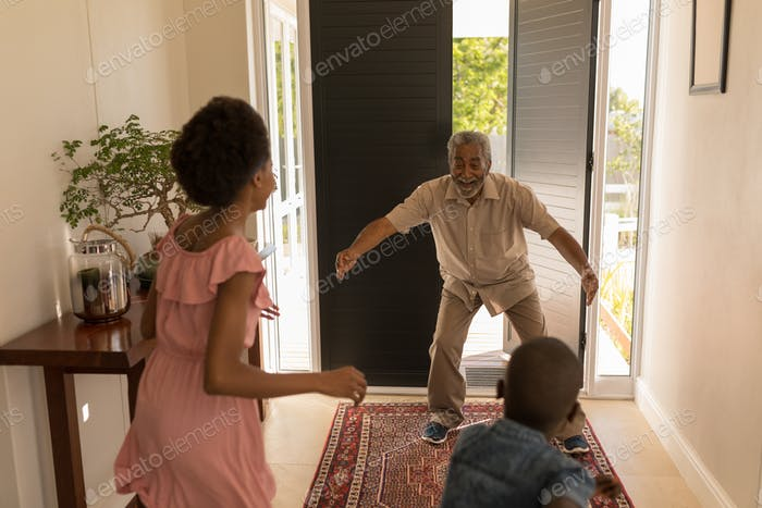 Grandfather got excited after seeing his grandchildren at home