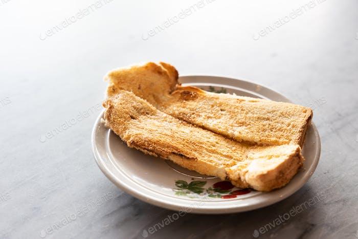 Toast bread with butter kaya, popular breakfast among Malaysian