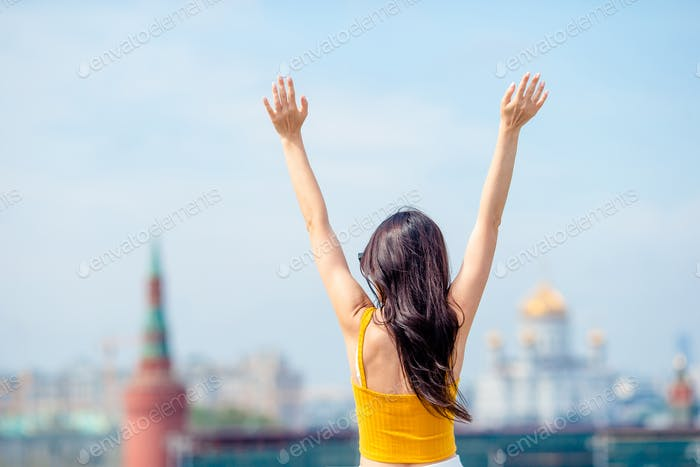 Happy young urban woman in european city