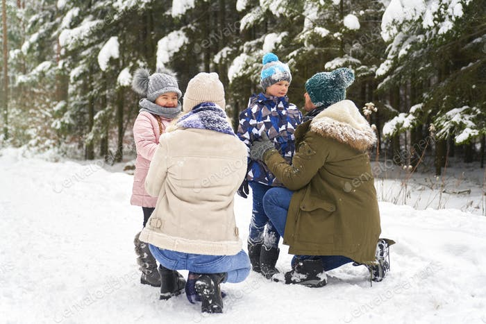 Family spending day outdoors at winter
