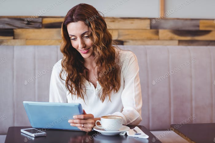 Woman using digital tablet in the coffee shop