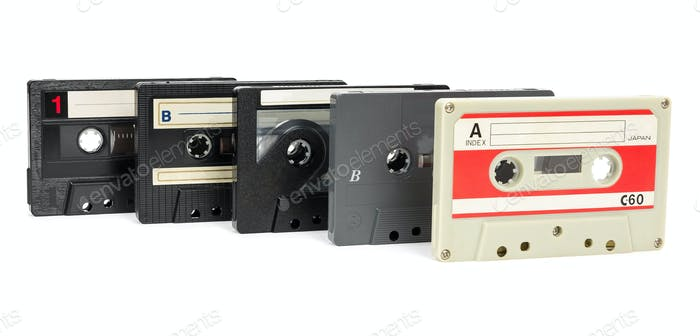 Set of vintage audio tapes on white background