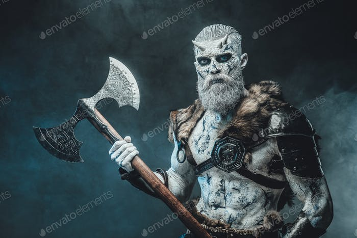 Evil warrior from north with huge axe in smokey background