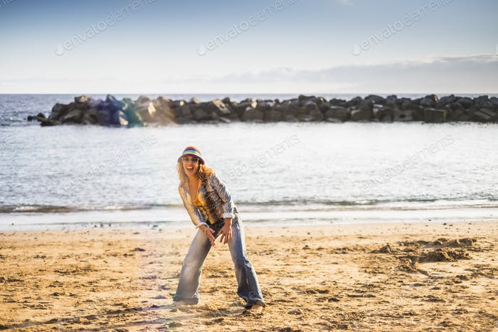 happy freedom crazy middle age woman on the beach cheerful and happy
