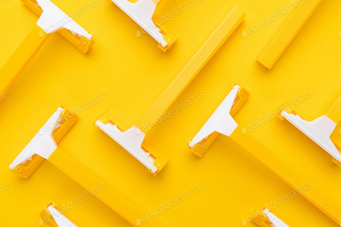 Razors On Yellow Background