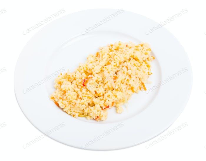 Delicious couscous porridge with tomatoes.