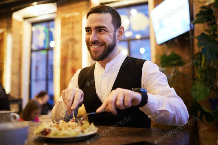 Businessman Eating Food n Restaurant