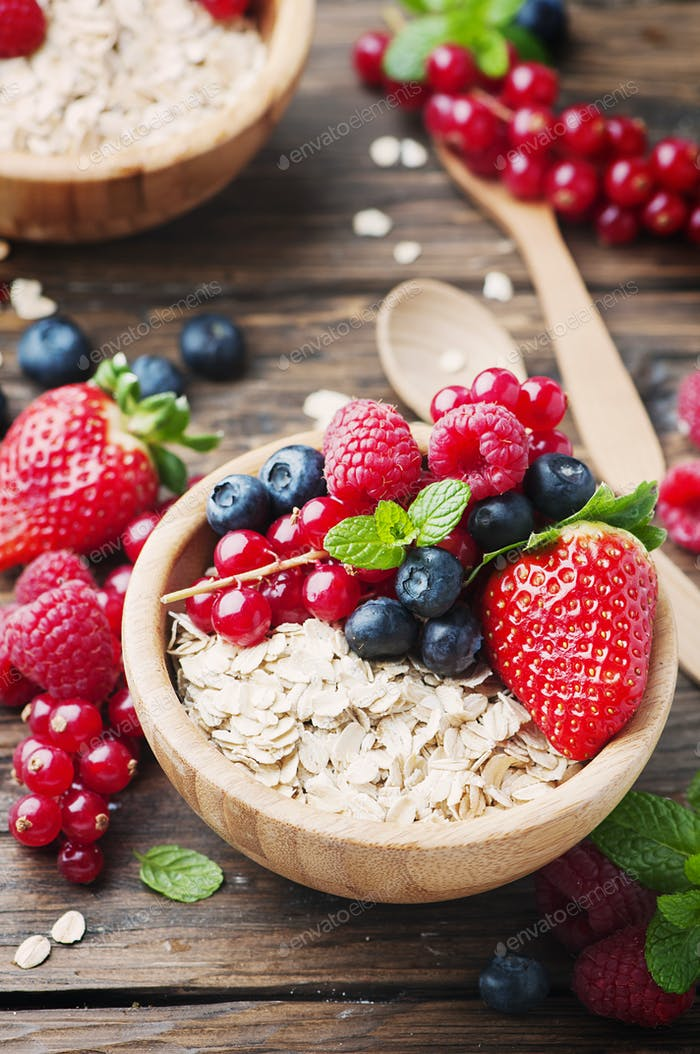 Oats withmix of berry on the wooden table