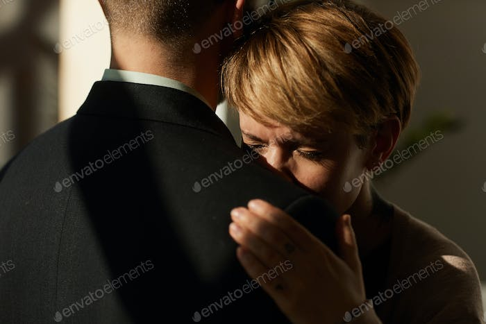 Man supporting the woman