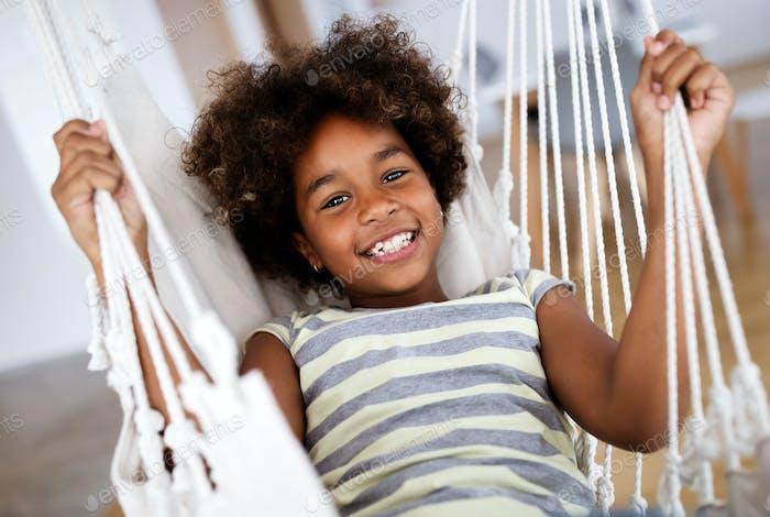 Happy playful preschool child girl having fun at home