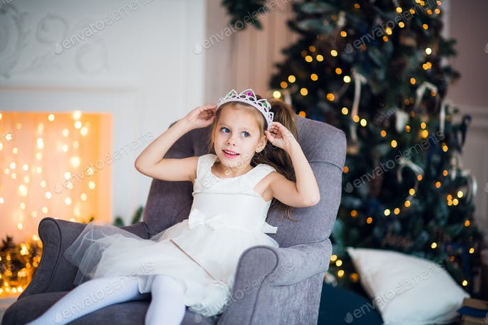 Portrait of the little girl in a suit of the snow queen