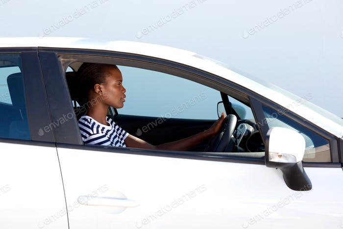 young african woman driving car