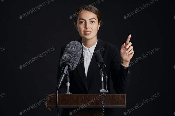 Confident Female Speaker at Podium