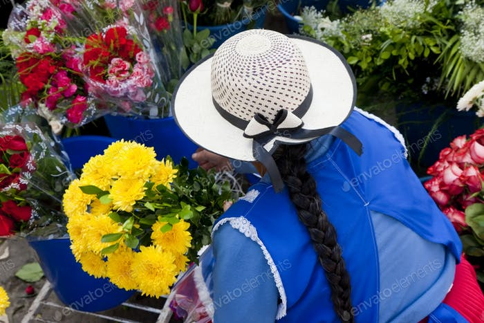 Woman selling flowers in South American street.
