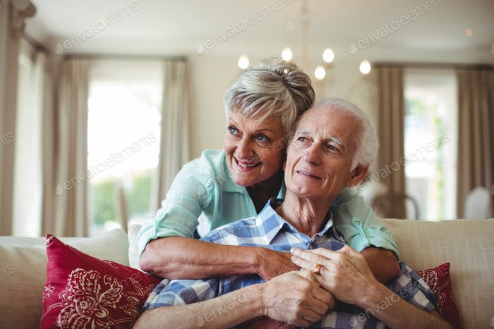 Senior couple relaxing on sofa in living room
