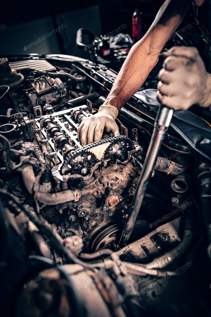 Mechanic working in a car