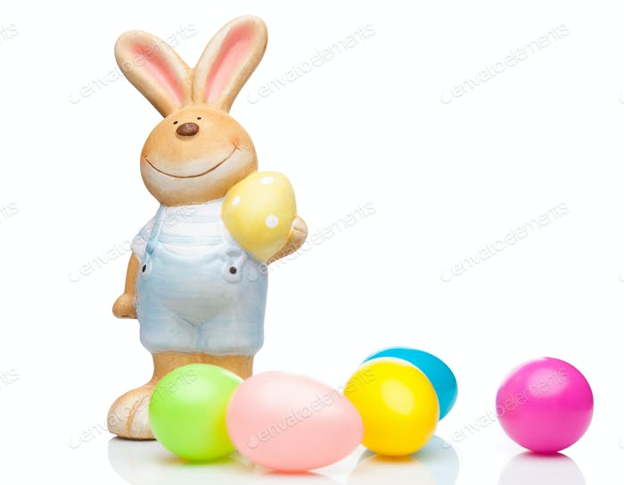 Easter holiday bunny and eggs on white background