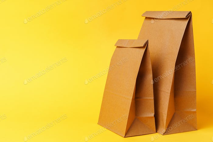 Craft packets on bright yellow paper background