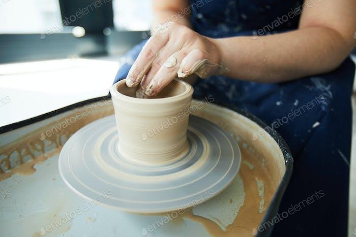 Making clay jug