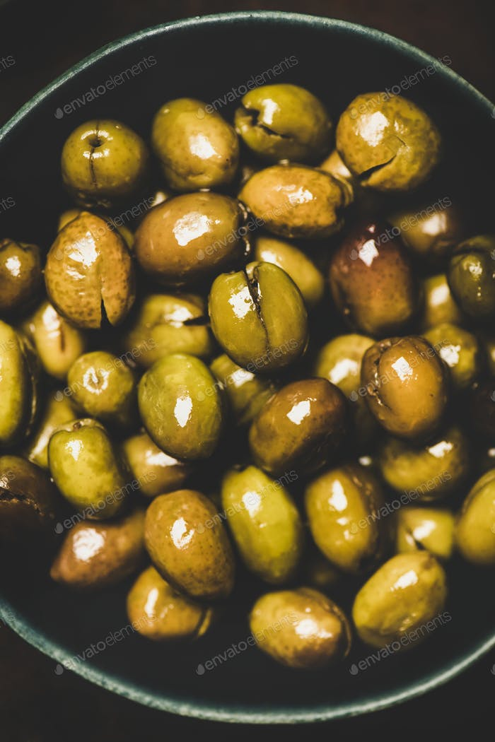 Flat-lay of fresh harvested pickled Mediterranean olives, close-up