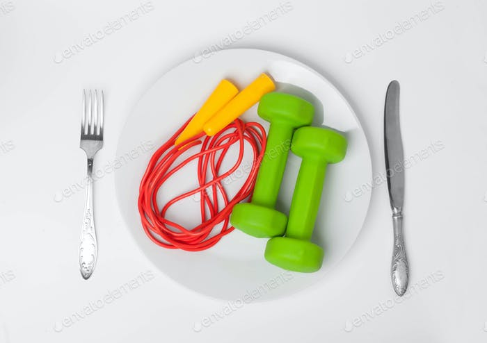jumping rope with dumbbells in food dish with cutlery
