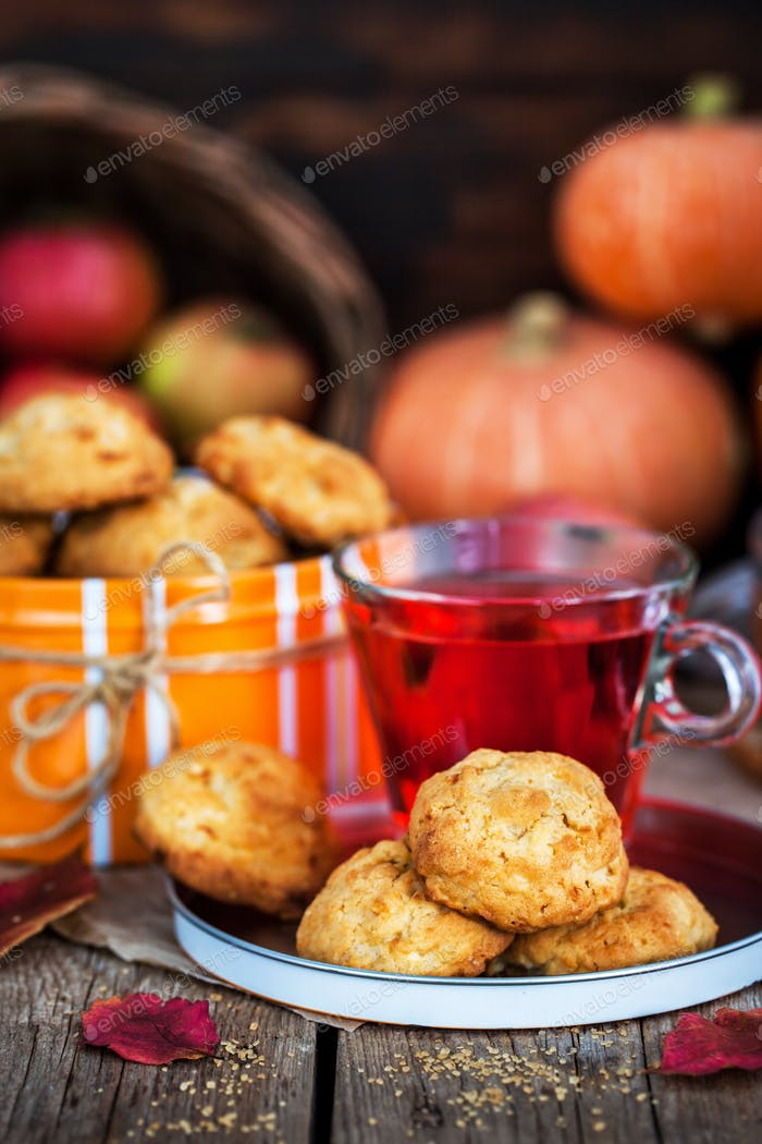 Fresh homemade delicious apple cookies and cup of hot red tea
