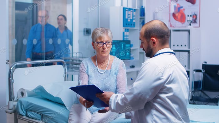 Senior patient signing medical decisions