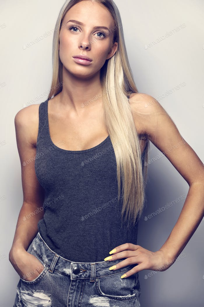 Confident Woman In Casuals Posing Over Gray Background