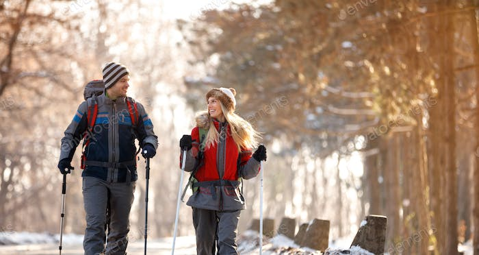 Boy and girl skiing in forest