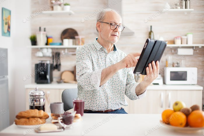 Elderly person with portable tablet PC