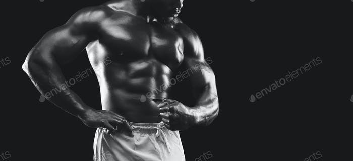 Muscular arms and torso demonstrated by african american bodybuilder