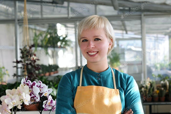 portrait of cheerful florist