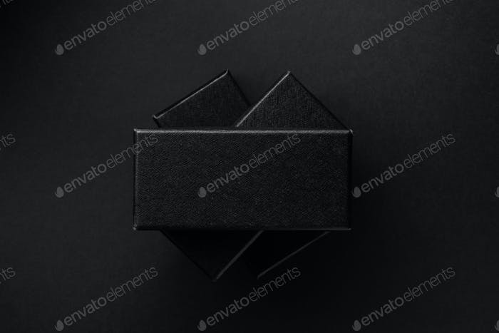 Black rectangular boxes on a black background. Place for text.