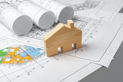 Architectural construction plans paper on table close up