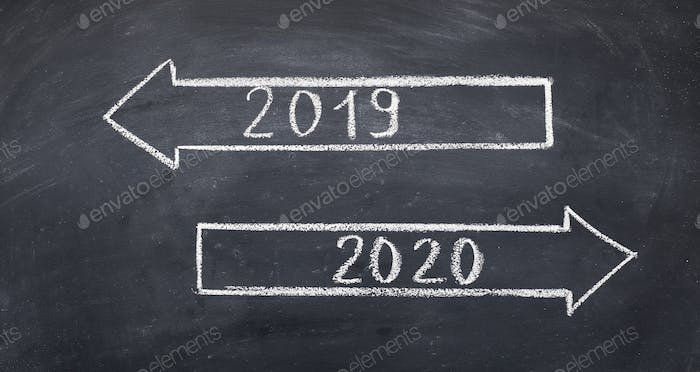 Two direction signs with arrows and numbers 2019 and 2020